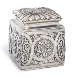 A silver tea caddy Fabergé, with Imperial Warrant, Moscow, 1892 the square hinged box repoussé and chased with floral motifs within meandering strapwork, gilt interior, 84 standard height: 12cm (4 1/2in).