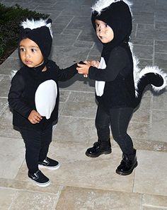 North West and her cousin Penelope Disick, wear skunk costumes for Halloween 2014