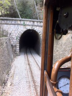 The historical wooden train passes through beautiful little caves and bridges in the Forest between Soller and Port de Soller. ----- More Information: http://www.nofrills-excursions.com/excursions-tours-thingstodo/port-alcudia/a-day-in-lluc-and-soller/
