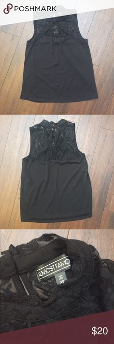 Almost Famous Top Great for going out. Never worn only tried on. New without Tag. Almost Famous Tops Tank Tops