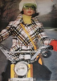 1970s vogue plaid coat jacket white black yellow gold turtleneck sweater beret hat motorcycled color photo print ad model magazine vintage fashion style winter fall looks