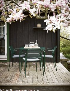 Mira Table and armchairs in hunter green design by Mia Lagerman