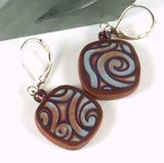 Mod earrings polymer clay purple copper pearl swirl. $40.00, via Etsy.