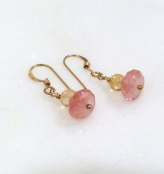 The lovely soft watermelon pink of these faceted watermelon quartz beads complements the transparent light champagne shade of the natural citrine beads in these handmade dangle earrings. The stones are simply wrapped with 14K gold filled wire and hung from 14K gold filled ear