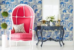 Maximize the glam with a hot pink accent chair and chinoiserie wallpaper.