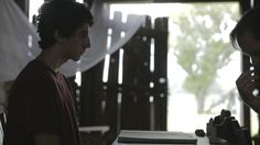 Christopher Fernandez as Alex and writer/director Cale Pascual rehearse a shot on location for Window Chalk