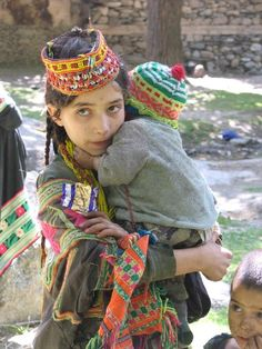 Kalash girl and baby brother or perhaps a nephew. He might even be her son. Tribes Of The World, People Of The World, Islam In Japan, Islamic People, Kalash People, Visit Japan, Islamic World, Alexander The Great, Cultural
