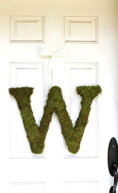 "Monogram letter for your door! These 18-20"" high, moss covered letters are constructed using real, live green moss. Wrapped around a wood laminate base, these letters will age naturally over time and they are designed to bring style to any living space indoors or out. Order any letter A-Z, or order three or more to spell out any word. A satin cream colored ribbon is included and finishes each letter with classic taste."