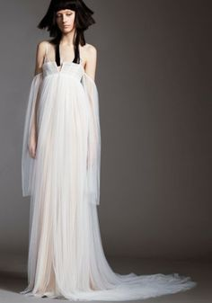 Light ivory silk mousseline chiffon empire gown with draped cutaway skirt with off-the-shoulder sleeve