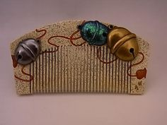 JAPANESE EARLY SHOWA PERIOD COMB WITH JAPANESE BELL DESIGN