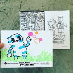Got a friendly character in the mail this morning, as @ruthietherobot (one of the artists from our robot coloring book - shown there in the background) draws all over our Doodle Addict postcard. #doodlersanonymous #doodleaddict #postcard