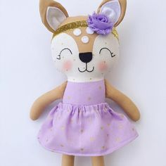This deer doll is made with love! She is about 15 inches tall and made from high quality cotton fabrics and wool blend felt accessories. Her face is hand embroidered and detailed with cute rosy cheeks. Extra outfits can be purchased to dress her in. Contact me if you would like