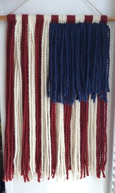 ≫ American Flag Yarn Wall Hanging *FREE US SHIPPING*   *4th of July Sale!* originally $40  Add a simple patriotic touch to any room with this handmade American Fall wall hanging  Each one is cut and strung by hand on a stained dowel using a blend of wool and alpaca fibers for an extra soft feel  Can be hung on a nail or tac from the attached twine  Measurements: ≫ Yarn hangs about 18 long (not including twine) ≫ Attached twine adds 3 to length but it is adjustable to your pref...