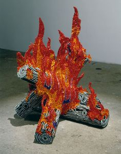 Dazzling sequin firelog installation.   Liza Lou, artist from New York. Fire, 2002