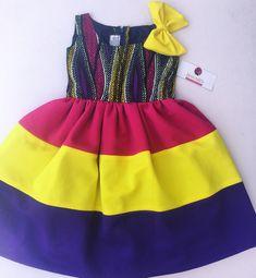 Ankara girls dress. African print wear. African wear for kids. African kids wear. African print girls dress. Ankara dress. Bayabs girls dress. Bayabs rainbow dress.