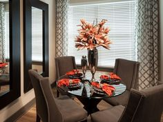 Elegant dinning area in a small space with the vertical mirrors to trick the eye! MIRRORS!