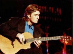 Mike Oldfield playing acoustic guitar (Amarok, Ommadawn + others) - YouTube