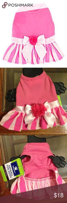 Top Paw Stripe Skirt Dress for dog or pet -Brand: Petsmart Top Paw -Size xxs for a small dog or puppy -Measurements: 6 inches in length & 4-4.5 inches in width -Never worn or tried on -Brand New! Tags attached -Bubblegum pink & baby pink -Cute flower & bow detail with ribbon -Comes from a smoke free pet free home (due to landlord rules my dogs do not live with me) bought the wrong size for my dog Other