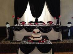 Black and white Damask head table with red accents by Absolute Events and Rentals (Vancouver)