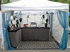 7 Outdoor Craft Fair Booth Ideas Youve Never Thought Of including curtains as display method, framed hanging boxes. Great ideas!