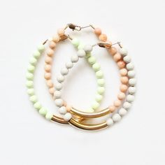 gemstone and gold tube bracelets available in peach marble, pale grey riverstone and lemon chrysoprase.   semi-precious stones | 6mm width  gold plated brass tube  lobster clasp closure