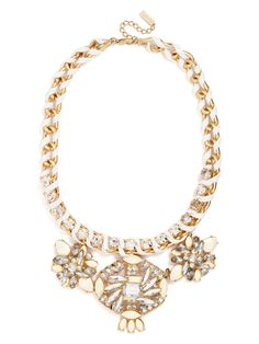 This gorgeous bib features large gem clusters with opaque stones and marquise crystals arranged in spiraling, pinwheeling designs. A chain wrapped in cord lends a monochromatic statement casual, crafty flavor.