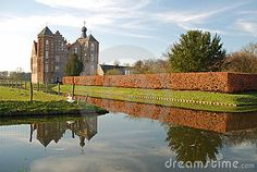 Dutch landscape with castle Croy - Laarbeek - reflecting in a canal - Noord-Brabant - Netherlands.