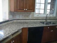 Granite Countertops installed in Charlotte with Tile backsplash (Subway tile design) -- ** Have real 3CM Granite Countertops installed at low wholesale prices! ** http://www.fireplacecarolina.com --- This kitchen has a 60/40 sink installed. The granite is fabricated with a half bullnose edge.    Come visit any of our locations to view granite slab...