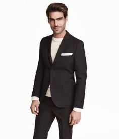 Blazer in woven fabric. Chest pocket, front pockets with flap, and two inner pockets, one with button. Decorative buttonhole on lapel. Buttons at cuffs and vent at back. Lined. Slim fit.
