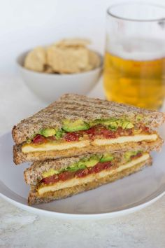 Smashed Chickpea, Roasted Tomato, and Avocado Sandwich with 'cheesy' tofu recipe ! Sounds so delicious !!  I really love the sound of the 'cheesy tofu'... Sounds fantastic! from Veggie and the Beast