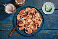 This is a dinner to evoke deep summer, when the heat lies heavy even at dusk and humidity wraps you like a blanket: shrimp tossed in garlic butter made fiery with Indonesian sambal and jalapeño, cut by lime, fragrant with cilantro. It is a kind of scampi for the sun-kissed and sun-desirous alike, a vacation on a plate. (Photo: Zachary Zavislak for The New York Times)