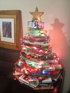 Christmas Tree made with books. Maybe a table top version would work in our library.