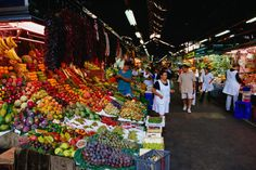This is the picture of the La Boqueria market in Barcelona. This is the greatest market ever. The picture shows only a small portion of the gigantic market. THe market has kiosks with ham, fruits, fresh fruit juices, candy, fish and breads. There are markets like these all over Spain. However this is one of the biggest and most popular!#2B