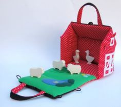 Fabric dollhouse tutorial: barn edition with toy animals. Too cute. There are many ideas for personalizing a portable fabric dollhouse on this page.