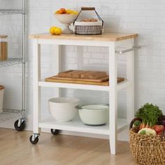 Add functionality to your prep area with the Trinity Wood Kitchen Cart. With a butcher block top, you have a solid work space that can handle heat exposure and impact. Its shelves offer room for pots, pans, and kitchen tools. Space Furniture, Furniture For Small Spaces, Find Furniture, Kitchen Furniture, Furniture Makeover, Furniture Decor, Furniture Websites, Furniture Plans, Furniture Buyers