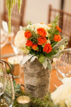 The pop of orange goes a long way in this colorful centerpiece.