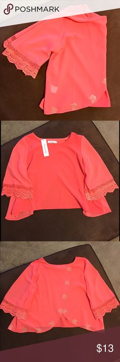 """Coral Jeweled Crop Open Back Blouse NWT.Size Medium. Half sleeve with a gorgeous lace design at the ends. Cropped length with an open swooped back that has a jeweled pattern following the sides. 100% Polyester. Measurements: Shoulder to end L- 19"""" / Shoulder to Shoulder- 15"""" /armpit to armpit / 18"""" / armpit to sleeve end- 9"""". Super cute with leggings or high waisted jeans! 💕                             ❕TOP RATED SELLER❕                📦 FAST SHIPPING‼️📦                💕Quick…"""
