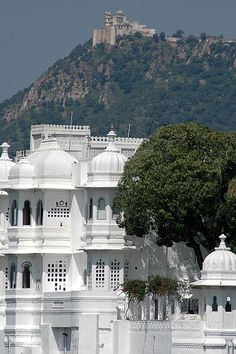 """Monsoon Castle - Udaipur, India ~ Sajjangarh, the """"Monsoon Palace"""" sits above Udaipur, and (in this picture) beh - Indian Architecture, Beautiful Architecture, Beautiful Places To Visit, Places To See, Places Around The World, Around The Worlds, Udaipur India, Hotels, North India"""