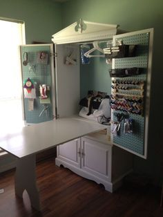 tv armoire turned into a sewing cabinet with fold up table brilliant
