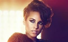 Alicia Keys....beautiful and one of the most talented artists in such a long time. Classically trained pianist and sexy!