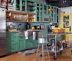 Awsome Loft, farmhouse chic, industial, setting, green painted kitchen, glass cabinets.