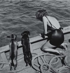 Martin Munkacsi, Woman on Boat, 1930s | vintage | sailing | dachshund | black & white | bather | vintage | sail | sausage dogs | mans best friend
