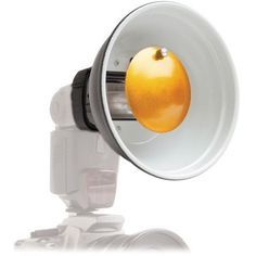 Polaroid Beauty Dish Diffuser For Canon, Nikon, Olympus, Sony, Panasonic, Pentax, Sigma & Other External Flash Units Polaroid,http://www.amazon.com/dp/B00CLCNH64/ref=cm_sw_r_pi_dp_krqFtb1AG6D4ZA0F