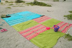 Giant beach blanket made by sewing towels together.