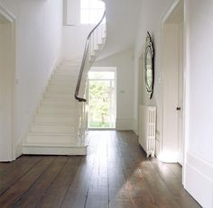 I love the white stairs. not sure we should do white stairs but makes the whole area so bright White Stairs, White Walls, White Wood, White Hallway, White Mirror, Brown Wood, White White, Snow White, Style At Home