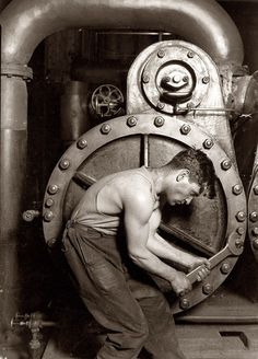 "Powerhouse Mechanic by Lewis Wickes Hine. This photo of ""powerhouse mechanic and steam pump"" is one of Lewis Wickes Hine's most famous works. 1920. Company photo courtesy of Shorpy. (s/n/1284)"