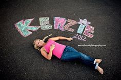 As this senior photo with chalk art from Velvet Owl Photography makes clear, chalk is a fun and easy way to inscribe your name, graduation year, or any other message you want commemorated in your senior photo.