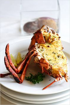 Baked lobster with garlic and cheese.Delicious lobster with cheese,garlic,light cream and bacon baked in convection oven.Yummy!!!