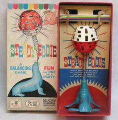 Milton Bradley Steady Eddie Balancing Game 1963 Plastic Seal Balances Ball and Sticks / MB Game in OB with Great Graphics by 6thAvenueCollection on Etsy https://www.etsy.com/listing/238710197/milton-bradley-steady-eddie-balancing