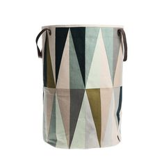 The Spear Laundry Basket designed by Trine Andersen has a chic, modern geometric print. Beautiful and functional. Great for any type of storage! There is also a matching shower curtain here: http://store.dwell.com/spear-shower-curtain.html